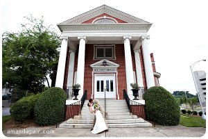 groom-dips-bride-in-front-of-charlotte-nc-wedding-chapel